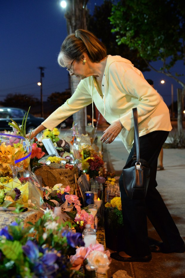Linda Birmingham was among the neighbors, friends and acquaintances of Mike Juarez who joined a vigil in his remembrance in front of the USA gas station on Hawthorne Boulevard in Lawndale where the homeless man was a regular presence for the past 30 or so years.Photo for The Daily Breeze by Axel Koester, 10/24/2017.