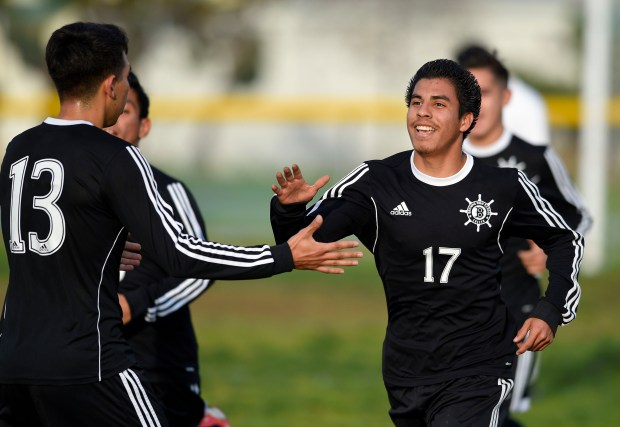After scoring a goal, Banning's Alex Zepeda, right, is congratulated by Alex Garza in Harbor City, CA on Wednesday, January 27, 2016. Banning boys soccer beat Narbonne 4-1 in a Marine League match. (Photo by Scott Varley, Daily Breeze)
