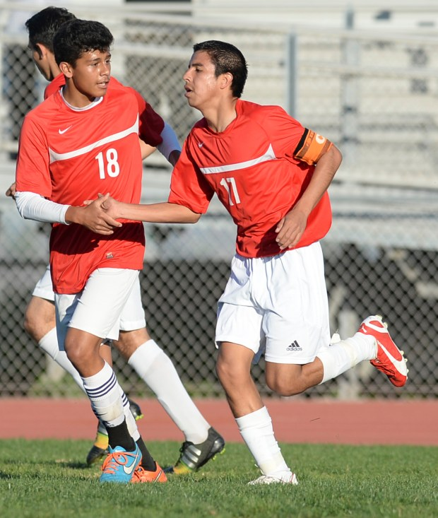 Banning's Christian Zavala (18) shakes hands with Alex Zepeda (17) after scoring against San Pedro in a Marine League soccer game Friday, February 06, 2015, San Pedro, CA.Photo by Steve McCrank/Staff Photographer
