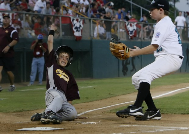 Cody Bellinger, then playing for the Chandler National Little League team, slides into home plate before Matty Kirkpatrick, Solana Beach, can tag him during the Little League Western Regionals championship game in 2007. Bellinger is now a star for the Dodgers. (File photo by Amanda Lucidon, The Press-Enterprise/SCNG)