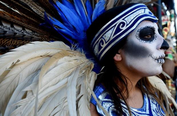 Ballet Folklorico de Riverside aztec dancer Ariana Alvarez waits to perform during Day of the Dead celebration on Market Street in Riverside, CA. Saturday, Nov. 5, 2016. TERRY PIERSON,THE PRESS-ENTERPRISE/SCNG