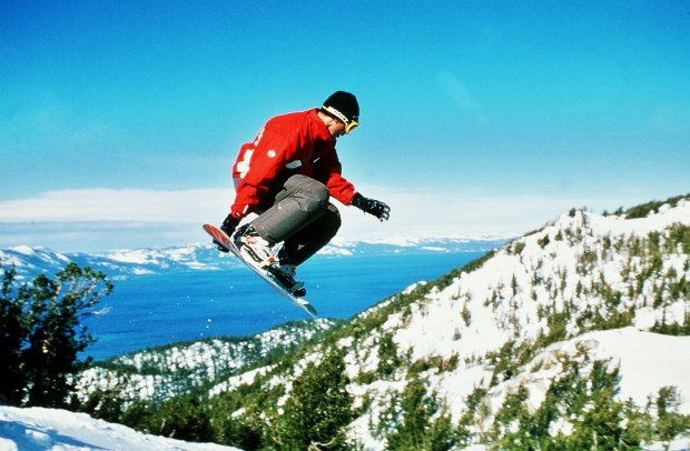 A snowboarder catches some air on the slopes at Heavenly Ski Resort in Lake Tahoe. Photo by Scott Markewitz/Heavenly Ski Resort