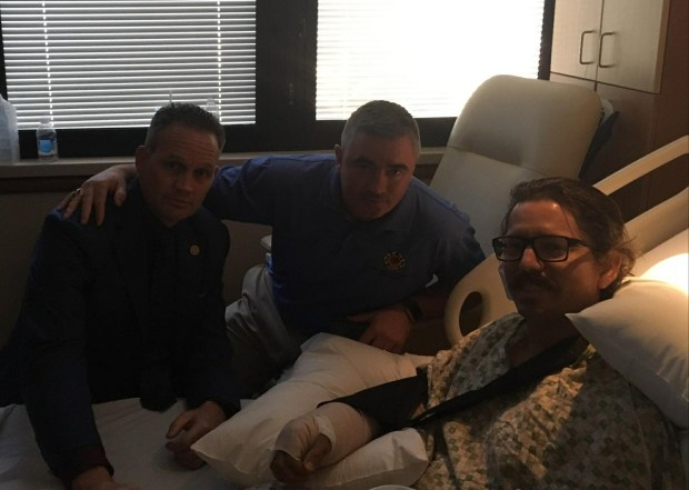 San Bernardino County Firefighter Mike Kordich recovering Tuesday in Las Vegas following Sunday's mass shooting. Also pictured are Ed Kelly (center), general secretary treasurer for the International Association of Firefighters (IAFF), and Frank Lima (L), 10th District Vice President of IAFF.
