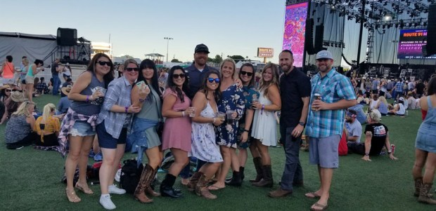 Teresa Nicol Kimura, 38, of Placentia attended the Route 91 Harvest country music festival in Las Vegas, where she died Sunday. She is seen in the front row, fifth from left. She attended the event with 7 other friends from Orange County, all of whom survived. (Photo from Chad Elliott via Facebook)