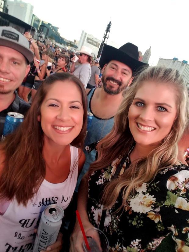 Pomona resident Lauren Lamandia (right) pictured with her boyfriend Philip Edwards (back right) and friends James and Patti Dobson at the Route 91 Harvest Festival in Las Vegas Sunday, Oct. 1. The four were at the concert when a gunman opened fire on the crowd. They all escaped. (Photo courtesy of Lauren Lamandia)
