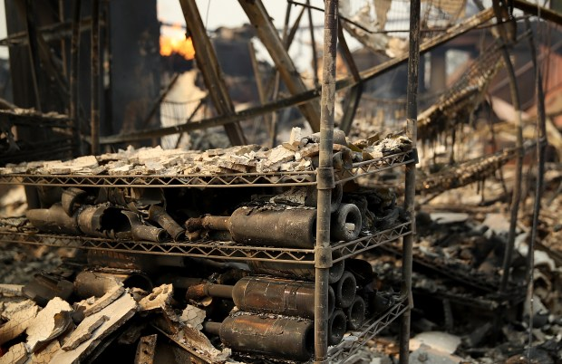 Burned out wine bottles sit on a rack at the fire damaged Signorello Estate winery after an out of control wildfire moved through the area on October 9, 2017 in Napa, California. Tens of thousands of acres and hundreds of homes and businesses have burned in widespread wildfires that are burning in Napa and Sonoma counties. (Photo by Justin Sullivan/Getty Images)