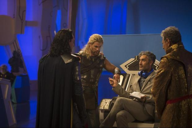 """Thor: Ragnarok"" director Taika Waititi (third from left) in consultation with stars Tom Hiddleston and Chris Hemsworth. Photo courtesy Disney."