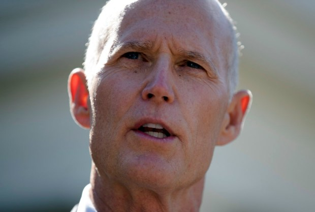 Florida Gov. Rick Scott talks to the media outside the West Wing of the White House in Washington, Friday, Sept. 29, 2017, after having lunch with President Donald Trump Vice President Mike Pence. (AP Photo/Carolyn Kaster)