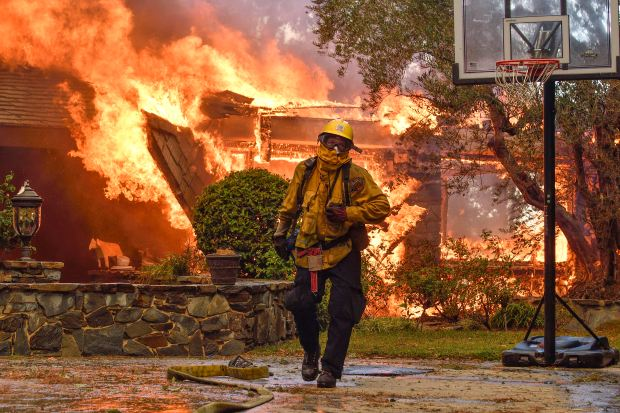 Fire fighters work to extinguish a fire on Via El Estribo during the Canyon Two Fire in Anaheim, California, on Monday, October 9, 2017. (Photo by Jeff Gritchen, Orange County Register/SCNG)