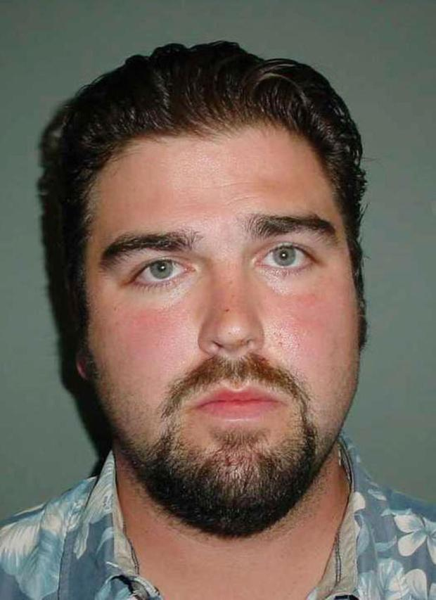 FILE - This undated file photo provided by the Costa Mesa Police Department shows Daniel Wozniak as he was booked for investigation of murdering 26-year-old Samuel Herr and 23-year-old Juri Kibuishi. California police say he shot, beheaded and dismembered Herr, his neighbor at a military base, then killed Herr's friend, Kibuishi, after using the dead man's cell phone to lure her to his apartment. Wozniak is expected to be arraigned Monday, June 1, 2010. (AP Photo/Costa Mesa Police Department, File)