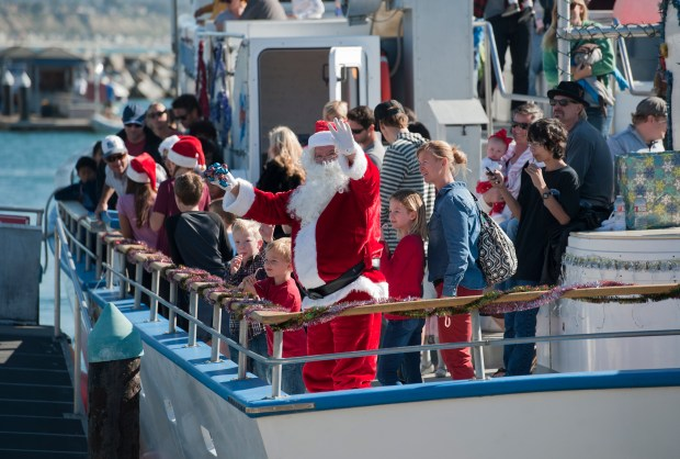 Santa waves to kids from the stern of the Dana Pride at the Dana Wharf Docks last year. PHOTO BY JEFF ANTENORE, CONTRIBUTING PHOTOGRAPHER