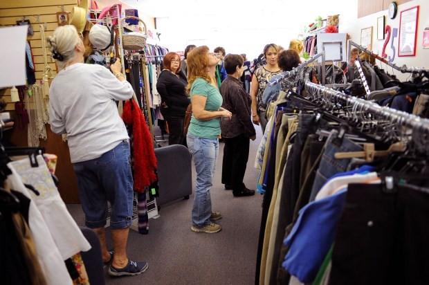 Customers browse for bargains at the Assistance League of San Fernando Valley's first thrift shop in Canoga Park, CA. The group held a grand opening for the shop Wednesday March 6, 2014.(Andy Holzman/Los Angeles Daily News)