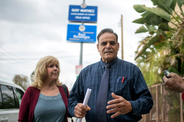 Activist Bonnie Corwin listens as Ricardo Benitez speaks during a press conference outside the Arleta district office of Assemblyman Raul Bocanegra, Wednesday, November 1, 2017. A group of women from his district is calling for his resignation after the revelation that he groped a woman at a Sacramento party nine years ago. (Photo by Hans Gutknecht, Los Angeles Daily News/SCNG)
