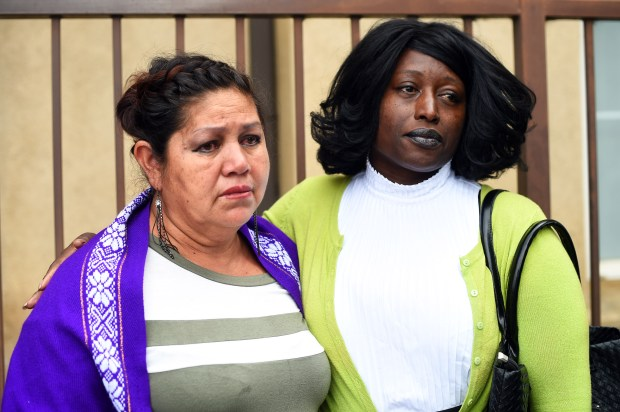 Margarita Cervarcio. left, is comforted by Gwendolyn Posey during a press conference outside the Arleta district office of Assemblyman Raul Bocanegra, Wednesday, November 1, 2017. A group of women from his district is calling for his resignation after the revelation that he groped a woman at a Sacramento party nine years ago. (Photo by Hans Gutknecht, Los Angeles Daily News/SCNG)