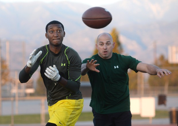 San Bernardino County Sheriff's Deputy Devin Manker, looks to catch a pass in front of fellow Sheriff's Deputy Derrick Alatorre, during a practice session at Citrus Valley High School in Redlands, Ca., Thursday, November 9, 2017. The police departments of Chino, Ontario, San Bernardino, and the San Bernardino County Sheriff's will team up to play on Saturday in a flag football tournament for charity called the Rain or Shine Bowl. (Photo by John Valenzuela/Redlands Daily Facts/SCNG)
