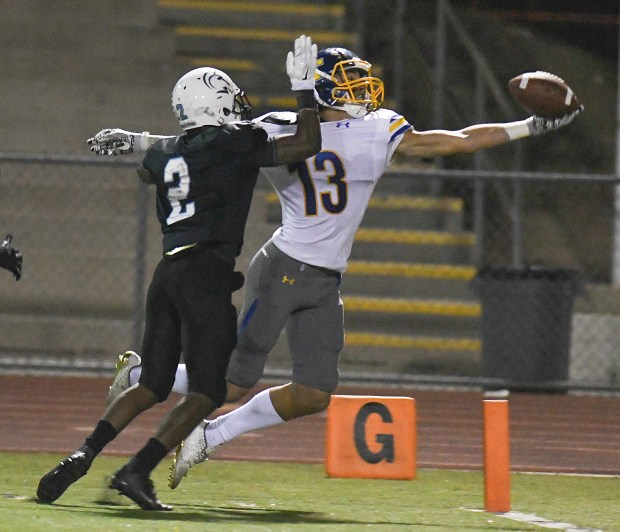 El Toro's Austin Derrico, right, catches a pass for a touchdown as Villa Park's Marcus Johnson defends during their first round CIF-SS Division 3 football playoff game at El Modena High in Orange, Calif., on Friday Nov. 10, 2017. (Photo by Michael Kitada, Contributing Photographer)
