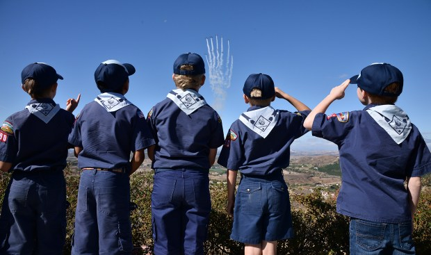 Cub Scouts from Pack 190 in Sherman Oaks stood and saluted the Tiger Squadron as they flew vintage aircraft in formation. The Ronald Reagan Presidential Library held its annual Veterans Day event that included a flyover, live musical entertainment, and a a civil war encampment, Simi Valley, CA 11/10/2017 (Photo by John McCoy, Los Angeles Daily News/SCNG)