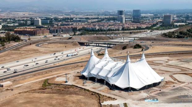 """The Irvine Co. plans to build office buildings at an empty lot adjacent to the 405 freeway, where Cavalia put its signature white touring tent for the """"Odysseo"""" show. (Photo by Mark Rightmire, Orange County Register/SCNG)"""