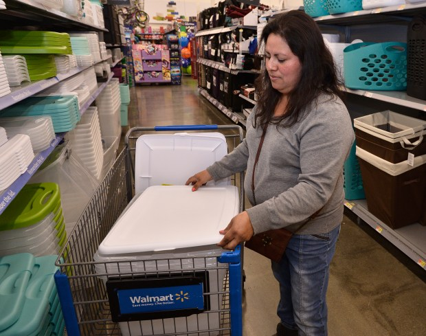 Emily Luque looks for storage bins at Walmart. Black Friday is just around the corner and Walmart is showcasing this year's hottest and most in-demand gifts for the holiday season at the mega retailer's Burbank location. Burbank, CA 11/16/2017 (Photo by John McCoy, Los Angeles Daily News/SCNG)