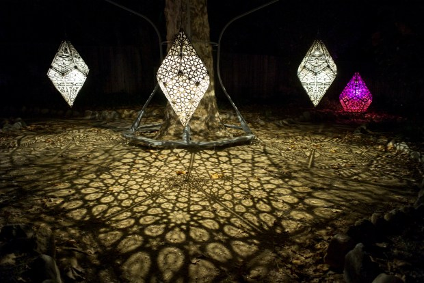The starlight garden with celestial shadows at the Enchanted Forest of Lights at Descanso Gardens Saturday evening. The show featuring interactive light displays and music runs through January 7th. ( Photo by David Crane, Los Angeles Daily News/SCNG)