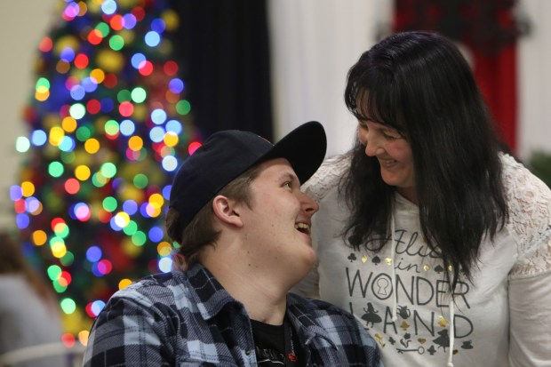 Nick Tusant, 17, of Hemet, laughs with his mother Jessica while touring Christmas trees being decorated for the annual Festival of Trees at the Riverside Convention Center on Monday, Nov. 20, 2017. The Mistletoe Magic gala and Holiday Boutique and Festivities raises support for pediatric programs at RUHS Medical Center, which houses the only pediatric ICU in Riverside County. Tusant was severely injured while crossing a street on the way to school and was cared for by the RUHS pediatric ICU team. (Stan Lim, The Press-Enterprise/SCNG)