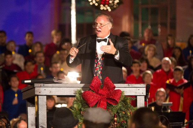 The Orange Community Master Chorale's Michael Short conducts the city of Orange's annual Tree Lighting Ceremony & Candlelight Choir Procession in 2013. This year's event will be held Dec. 3. (Register file photo)
