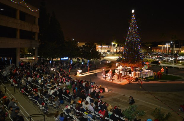 People gather in this file photo at the Brea Civic & Cultural Center for the city's annual tree lighting ceremony. This year's event will be Dec. 7. (Register file photo)