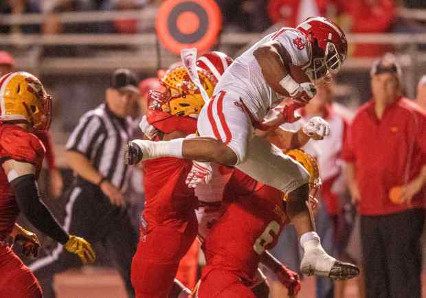 Mater Dei's Amon-Ra St. Brown jumps over Mater Dei defenders for some extra yardage in the semifinals of the Division 1 football playoffs in Mission Viejo on Friday,24, 2017. (Photo by Paul Rodriguez, Orange County Register/SCNG)
