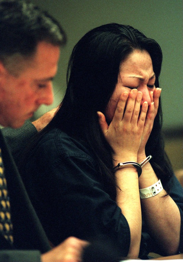 "Jeen ""Gina"" Han was sentenced to 26 years to life in prison in May 1998 for conspiring to kill her sister, Sunny Han, with whom she shared a love-hate relationship, police said. Shown above in 1997 with her attorney. (Photo by Ygnacio Nanetti, Orange County Register/SCNG)"