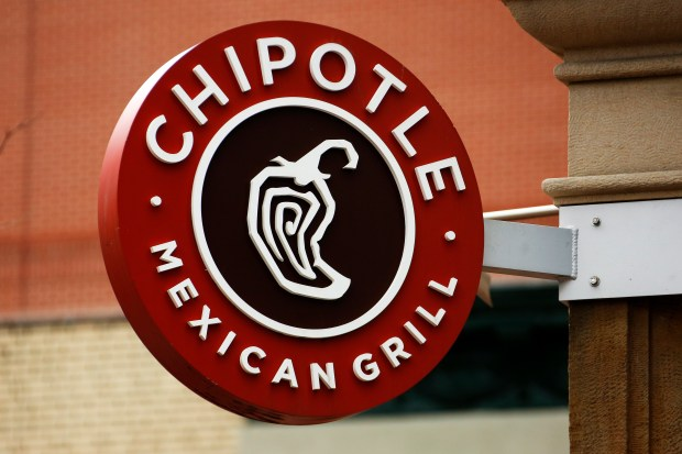 FILE - In this Jan. 12, 2017, file photo, a Chipotle restaurant sign hangs in Pittsburgh. Chipotle says it is looking for a new CEO. Its founder, Steve Ells, who currently serves as CEO and chairman, will become executive chairman once someone new is in place at the top post. (AP Photo/Gene J. Puskar, File)