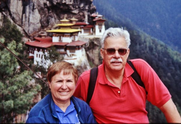Gail and Ladd Seekins in front of the Tiger's Nest Monastery in Bhutan (Photo courtesy of Ladd Seekins)