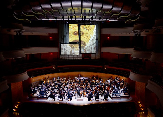Conductor Carl St. Clair leads the Pacific Symphony in Anton Bruckner's Symphony No. 8 in C Minor at the Henry Segerstrom Concert Hall. The orchestra offers some tempting holiday discounts. (Photo by Nick Koon, Contributing Photographer)