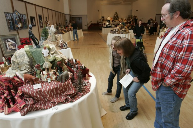 "Tony Gervasi, his wife, Carol and their daughter Katie, 9, look at the creche exhibit at The Church of Jesus Christ of Latter-Day Saints in Simi Valley, Friday, December 4, 2009.Simi Community Christmas is a gift to the community of Simi Valley sponsored by The Church of Jesus Christ of Latter-Day Saints. It features an international crche exhibit of over 500 nativities, including a ""live nativity"". This year there will be 30 new international pieces displayed. Each area of the displays will host guides who can tell the stories of the different nativity scenes. We exhibit hundreds of crches from the very elaborate to simple child-like expressions and created from ceramic, porcelain, wood, mud and dung, head of the pin, gourds, painted goose egg, rice, origami's, bark, and many others. Complementing the beautiful displays will be a series of mini concerts featuring over 300 performers from the community performing a variety of music. The creche exhibit and and concert series will be December 4, 5, 6, & 8TH. (Michael Owen Baker/staff photographer)"