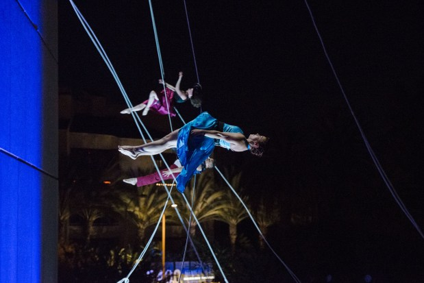 Guests marveled at the  gravity-defying choreography from the vertical dance troupe Bandaloop at the Argyros Plaza's opening festivities Oct. 27