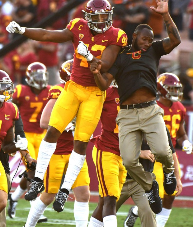Uchenna Nwosu, left, reacts on the sidelines during the Trojans' win over Texas at the Coliseum on Sept. 16. (Photo by Keith Birmingham, Pasadena Star-News/SCNG)