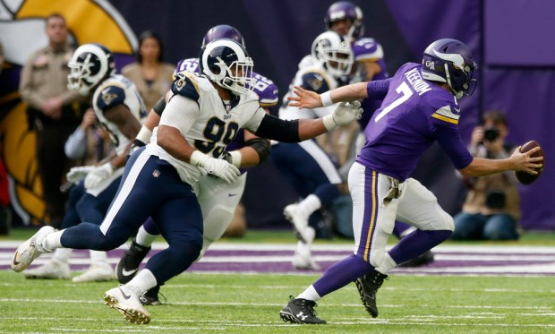 Minnesota Vikings quarterback Case Keenum (7) runs from Rams defensive end Aaron Donald during the first half of Sunday's game in Minneapolis. (AP Photo/Jim Mone)