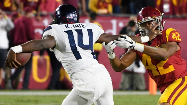Arizona quarterback Khalil Tate tries to elude USC linebacker Uchenna Nwosu in the first half of last Saturday's game at the Coliseum. (Photo by John McCoy, Los Angeles Daily News/SCNG)