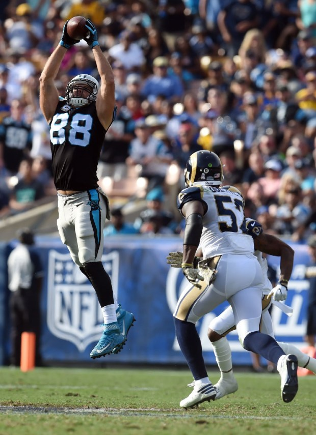 Carolina's Greg Olsen makes a catch near the Rams' Alec Ogletree during a game at the Coliseum in 2016. (Photo by Hans Gutknecht, Los Angeles Daily News/SCNG)