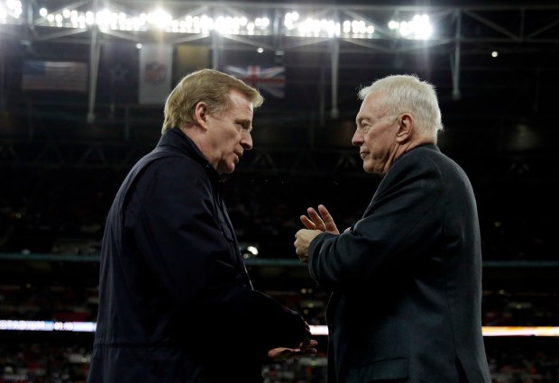 NFL commissioner Roger Goodell, left, and Dallas Cowboys owner Jerry Jones talk during an NFL football game in 2016 in London. The NFL expects a five-year contract extension with Goodell to be finalized soon, despite a threatened lawsuit by Jones. (AP Photo/Matt Dunham, File)