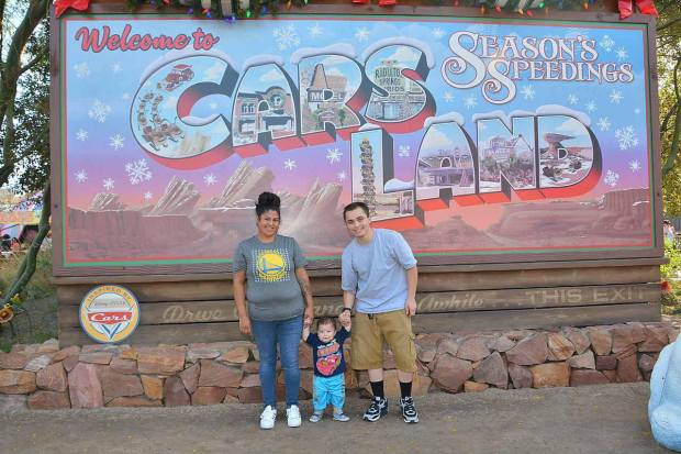 Brittni Medina and her husband, Marcus, with their 10-month-old son, Micah, shortly after Marcus snapped a photo of her breastfeeding undraped in line at Disney California Adventure. The family was waiting in line for this photo opportunity at Carsland. Photo courtesy of Brittni Medina.