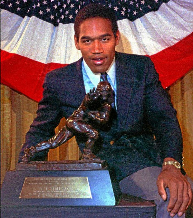 O.J. Simpson poses with his Heisman Trophy in New York City on Dec. 5, 1968. When the Heisman is awarded, the player gets one and his school gets the another. Simpson sold his to partially pay the wrongful death judgment against him, and USC's was stolen in 1994. (Associated Press file photo)
