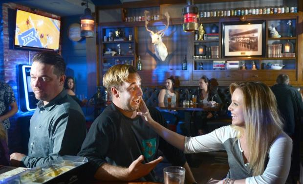 Mike Magnuson and Kristen Adams share a drink at the Stag Bar & Kitchen, a great place for a cup of holiday cheer.
