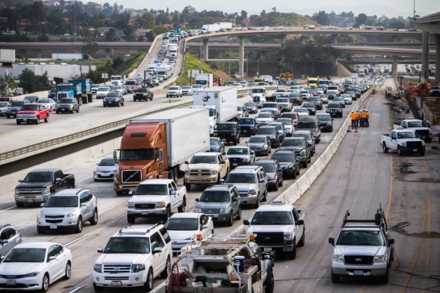 The new toll lanes and general lanes are nearly completed as commuters travel in traffic on the westbound 91Freeway through Corona on Wednesday, March 15, 2017. The new lanes are set to open Monday morning, March 20. (Photo by Watchara Phomicinda, The Press-Enterprise/SCNG)