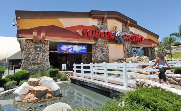 A patron walks into the main entrance at Soboba Casino in San Jacinto Thursday. The fountains in fron of the casino have been turned off to conserve water.