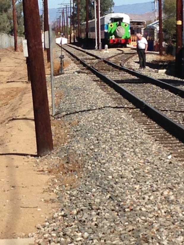 A volunteer inspects the tracks at the Orange Empire Railway Museum in Perris on Monday, Nov. 6, after an out-of-control vehicle nearly hit guests on Sunday, Nov. 5.Photo by David Downey, staff