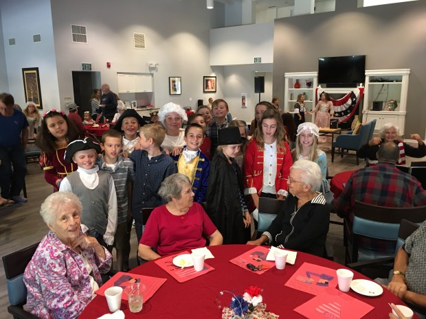 Military widows share stories with the 5th grade students from George White Elementary on Nov. 4 in Laguna Niguel. (Courtesy of Mike Young)
