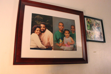 Family photos hang on the wall of the Valentines' home in Lisle, Ill. (Jenny Gold/Kaiser Health News)