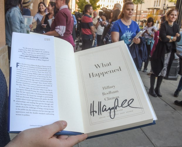 "All' Wiltshire, 28 of South Pasadena holding a signed copy of ""What Happened"". Hillary Clinton signing copies of her book, ""What Happened"", at Vroman's Bookstore in Pasadena Friday, December 1, 2017 (Photo by Walt Mancini/Pasadena Star-News/SCNG)"
