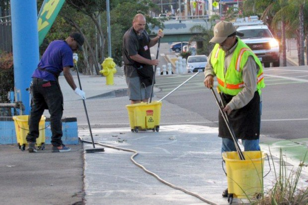 A cleanup team works on Reseda Blvd. (Courtesy photo)