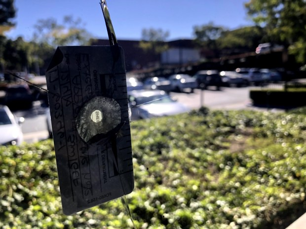 The image shows a hole in one of the windows of Jerry Slusiewicz's office in Laguna Niguel. He resigned from the Laguna Niguel City Council on Dec. 5, 2017, a day after he discovered the possible bullet hole. (Tomoya Shimura, Orange County Register/SCNG)